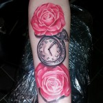rozes and clock tattoo